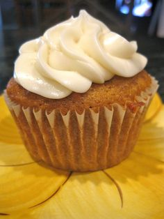 emma the joy: pumpkin cupcakes with cream cheese frosting.
