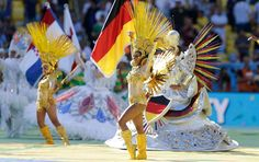 DANCERS PERFORM DURING IN FRONT OF A GERMAN FLAG BEFORE THE START OF THE WORLD CUP FINAL SOCCER MATCH BETWEEN GERMANY AND ARGENTINA AT THE MARACANA STADIUM IN RIO DE JANEIRO, BRAZIL. #FIFAWorldCup, #ClosingCeremony,  #WorldCup2014Pictures, #WorldCup2014Performances, #FifaWorldCup2014Fireworks, #Rio
