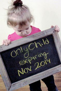 Only child expiring when new baby sibling comes for baby announcement picture