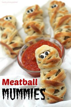 These Meatball Mummies are like hearty little meatball sub sandwiches ... with eyes. Easy to make, tasty to eat and ghoulishly fun for any Halloween party. #halloween #recipes