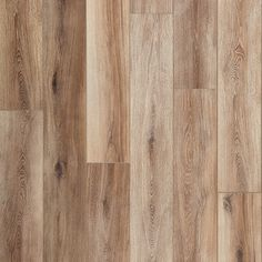 """Mannington laminate. Inspired by the always in style European White Oak, Fairhaven is a laminate wood visual floor that creates a comfortable and classy feel. The 8"""" wide plank and the warm undertones of the grain are a winning combination.</p>"""
