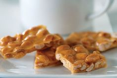 Get out the PLANTERS Dry-Roasted Peanuts to make a peanut brittle that looks like it came from a candy shop—when in fact it came from your microwave!