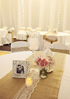 Rustic wedding table decorations with burlap and lace.