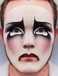 Sad face, mime make-up, sad face paint. Theater make-up, facial expression.