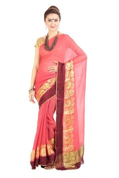 This Orange Saree Designs are beautiful and the unique design of this orange sari makes me look at it again and again. This orange saree with designs of golden zari and reddish brown velvet looks and feels really very royally stylish and classy . .
