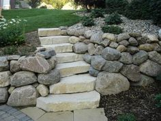Retaining walls made with boulders can create a natural effect on a hard-to-manage hillside. Description from perennialgardens.biz. I searched for this on bing.com/images