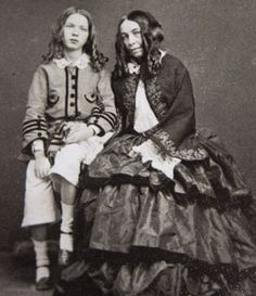 Elizabeth Barrett Browning (right) and her son Robert Wiedemann Barrett Browning [1860]. She was one of the most prominent poets of the Victorian era.