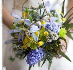 iris, hyacinth, mum, teddy bear sunflower, thistle, grapevine, and gooseneck fern bouquet.
