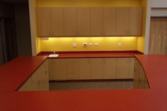 Custom Laminate cabinetry and countertops, featuring a Karran Seamless undermount sink. Brea, CA.