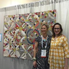 """""""With Jennifer Sampou, who happened to walk by. Her fabrics are the two main fabrics in this quilt! Perfect timing."""""""