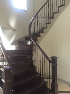 Curved stair case with dark wood