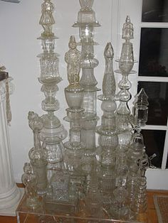 sculpture tower/candle sticks from old glass