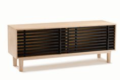Machiya Sideboard  By Liam Mugavin www.liammugavin.com  Machiya Sideboard continues Liam's exploration of the Japanese aesthetic concept of 'Ma', focusing on negative space and the intervals formed by wooden lattices as found in traditional Kyoto townhouse architecture known as Machiya.  The phenomenon of void created by repeating lines, gave way to a mode of thought and questioning; What happens when you fill this negative space and what would best fill it?
