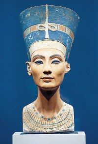 Ancient Egyptian: Nefertiti of the New Kingdom, Flat Crown and Uraeus; also wearing a beaded collar.