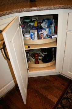 wood lazy susan in a diagonal corner base cabinet