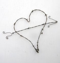 Gnarly Barbs Large Rustic Barbed Wire Heart With Arrow. $25.00, via Etsy.