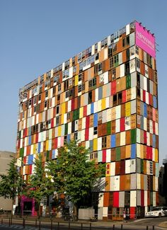 """A """"construction shield"""" made of 100 recycled doors turns an eyesore into a visual celebration."""