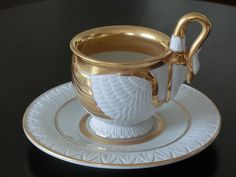 R.P.M. Germany 1900. Cup and saucer in shape of a swan. Embossed feathers. White with gilt.