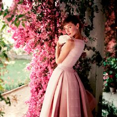 Six Breathtaking, Rarely Seen Photos of Audrey Hepburn |  | In her signature Givenchy, Hepburn was snapped by Norman Parkinson in 1955 for Glamour magazine. The photo was taken at La Vigna, a villa just outside of Rome that Hepburn rented with her husband Mel Ferrer to relax in between shoots for War and Peace.