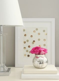 Love to do this DIY Art -- circles cut from shiny gold and glittery gold/silver scrapbook paper placed onto a white mat in a white frame.