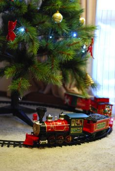 loving the traditional train set under the christmas trees definitely doing this