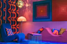 Bright swirls of colors gives this room a funky and disco-type feel. Can't you imagine rocking bell-bottoms in this room?