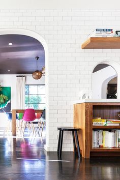 A peek at the colorful dining room through the kitchen's archway