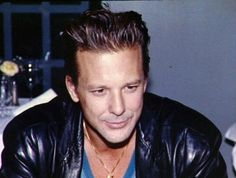 Mickey Rourke. Stay away from botox people. Hot!