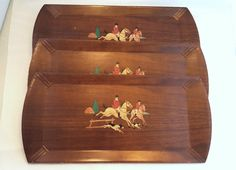 A beautiful set of 3 wooden trays with lithograph of an English Hunting Party.  Dressed in their Equestrian finearies, with groomed horses and their trusty English Springer Spaniels to find that fox!! ~Each tray measures 16 Long X 7 3/4 Wide x 1/8 Thick  ~ some scratches on the surface, see photos for details and condition  ~Coronet by Haskelite Mfg. Company in Chicago  ~Photos are of actual items   Please browse the other items in my store;  https://www.etsy.com/sear...