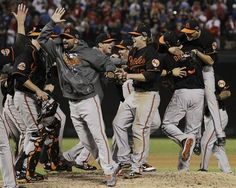 The Baltimore Orioles celebrate winning the American League wild-card playoff baseball game against the Texas Rangers