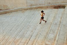 Sportswoman jogging down on steps by Guille Faingold - Sportswoman, Runner - Stocksy United Urban Fitness, Jogging, The Unit, Stock Photos, Travel, Walking, Viajes, Destinations, Running