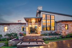 Using soaring ceilings and oversized windows to let in bright, natural light and views of the surrounding Texas landscape, designer Paula Ables blurs the lines between indoor and outdoor living in this Austin, Texas home. From the experts at HGTV.com.