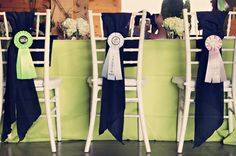 great idea! Order rosettes in wedding colors, use as decorations, save the dates, etc...so cute!