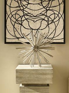 A @Kelly Wearstler signature: brass kaleidoscope balls add #design #texture to a linear surface