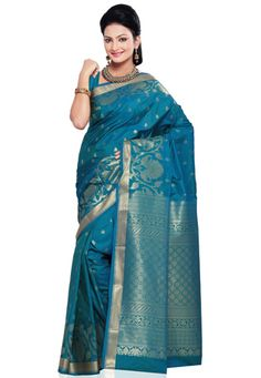 Short tone turquoise blue and green art silk zari woven saree. As shown short tone turquoise blue art silk blouse fabric is available and the same can be customized in your style or pattern; subject to fabric limitation, as the fabric is just drape on the model. (Slight variation in color is possible). data-pin-do=