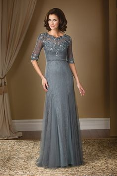 Jade Couture. Make a stylish statement at your next special occasion with this Soft Tulle gown. The boat neckline and A-line gown come together in this dress with lace detail throughout the dress and beaded details along the sash.