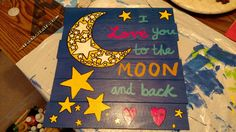"""My daughter loves the """"Guess How Much I Love You"""" book and its famous quote. I painted this using a wood pallet board from AC Moore, acrylic paints, and star stencils. Then, I spray sealed it with Modge Podge to protect the paint."""