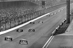Gordon Johncock leads Tom Sneva, AJ Foyt, Bobby Unser and the rest of the field into Indy's Turn 1 early in the race in 1977.