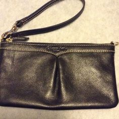Black leather Dooney and Burke wristlet Black patent wristlet with a small pocket inside. Comes with strap attached. Dooney & Bourke Bags Clutches & Wristlets