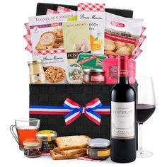 This luxurious gourmet French gift hamper overflows with the finest French sweets and savories, paired with a rich bottle of red wine. The perfect gourmet gift basket for people who love French cuisine and the finer things in life.