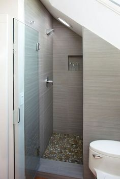 Shower Walls: Zera Annex Olive 12 x 24 • Shower Floor: Wilderness Pebbles