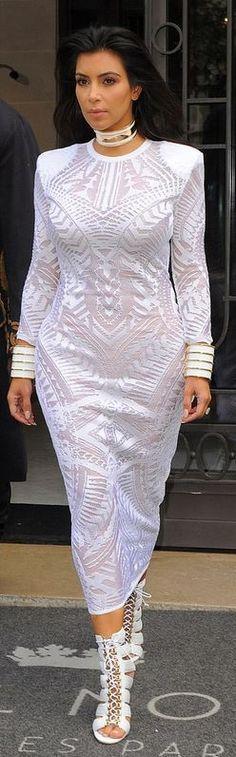 Who made Kim Kardashian's long sleeve print dress and white lace shoes that she wore in Paris