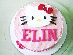 get a hot pink cake and add a hello kitty on it