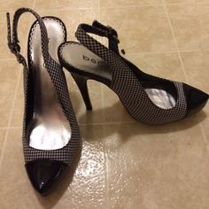 "Bebe shoes Black and white (checkers) high heels 5"" sling back Bebe shoes .  Only used a couple of times. Beautiful , elegant and perfect condition . bebe Shoes Heels"