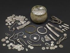 """The Vale of York Viking Hoard (Harrogate Hoard, 10th Century) of 617 silver coins and 65 other items. It was found undisturbed in 2007 near the town of Harrogate in North Yorkshire, England. The hoard included objects from many diverse locations, Samarkand in present-day Uzbekistan, North Africa, Afghanistan, Russia, Ireland, Scandinavia, and continental Europe, """"illustrating the breadth of the Vikings' travels and trade connections"""