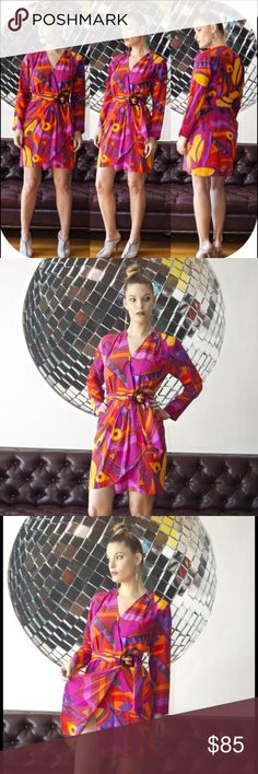 """Vintage Emilio Pucci Style Silk Wrap Dress D E S C R I P T I O N:  Featuring an abstract """"Pucci"""" like print in bright colors, a wrap style with inner hook closure and tie waist that secures through a tortoise effect scarf belt buckle, a deep V that can be snapped closed for a more modest look. This is a great 80's piece with it's bold print but soft silhouette.  S I Z E :  6 will best fit a modern size Small    F A B R I C : 100% Silk  S L E E V E : 22.5""""   B U S T : 20""""   W A I S T : 14""""…"""