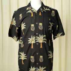 Caribbean De Palm Camp Shirt:This shirt makes me want a pineapple drink! It's a black button down with a print of palm trees and pineapple drinks throughout. It has a front pocket and coconut looking buttons. 55percent cotton and 45percent rayon. Machine washable. $42.00