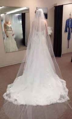 New (Un-Altered) Ivory Veil: buy this accessory for a fraction of the salon price on PreOwnedWeddingDresses.com