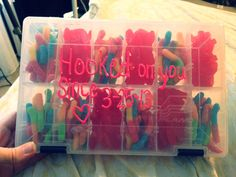 """""""Hooked on you"""" Tackle box with gummy worms and sweedish fish for my fishing crazy man."""