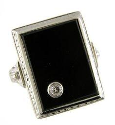 Art Deco black onyx and old European cut diamond ring.